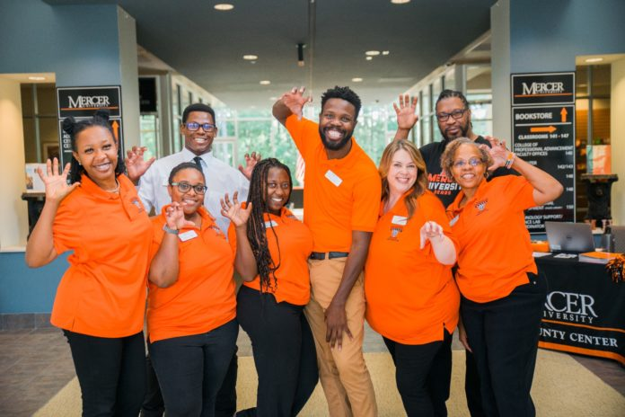 Student ambassadors make hands into bear claws